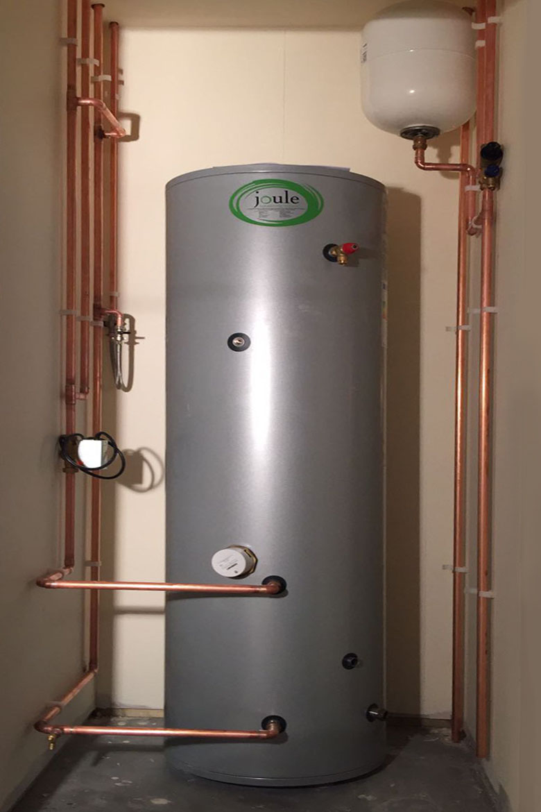 Hot water tank in cupboard